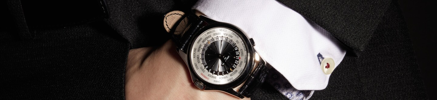 a man wearing a patek philippe watch that was sold in an auction selling vintage patek philippe watches