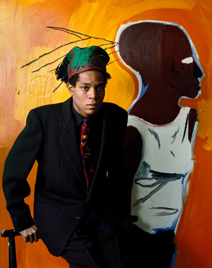 21 Facts About Jean-Michel Basquiat: Portrait in front of a yellow painting