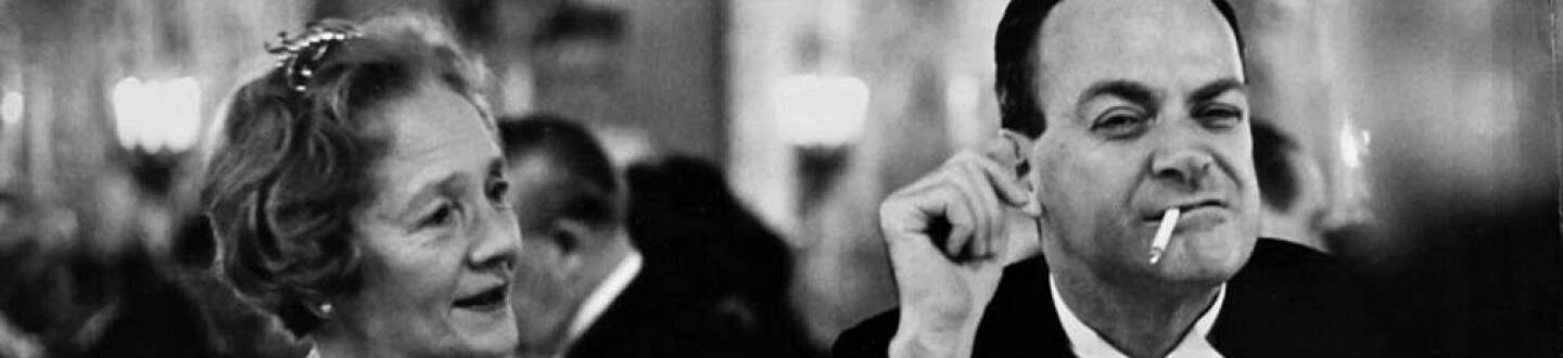 Physicist Richard Feynman at the 1965 Nobel Banquet making a funny face with a cigarette in hi mouth.