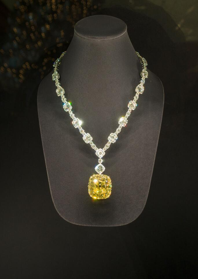 37a8f803d Tiffany Yellow Diamond. Mounted in a necklace of white diamonds. On display  at the
