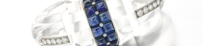 Boucheron rock crystal sapphire diamond bangle jewelry selling at an auction of extravagant jewelry