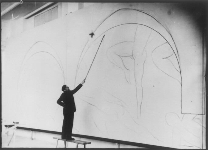 Henri-Matisse-works-on-Danse-II-at-the-Barnes-Foundation.-Matisse-attached-charcoal-to-the-end-of-a-long-branch-of-bamboo-while-completing-the-underdrawing-for-the-mural.jpg