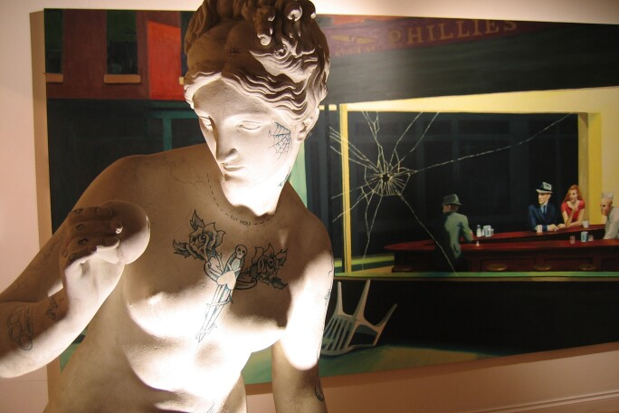 An installation view of Banksy's Crude Oils exhibition in London in 2004 with adapted versions of the Venus de Milo and Edward Hopper's Nighthawks.