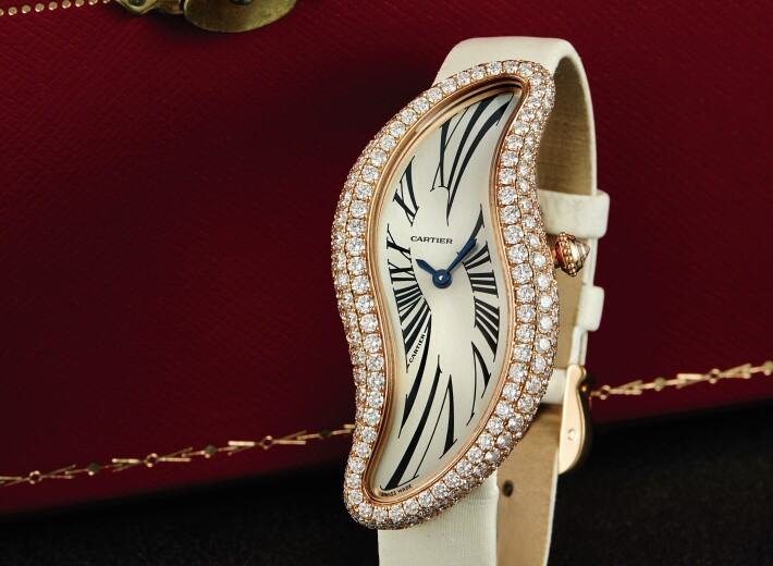 A Cartier Baignoire women's watch with diamonds in an auction selling Cartier watches