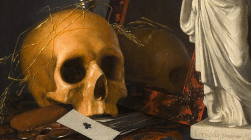 still life with skull on table with coins card porcelain statue and mirror