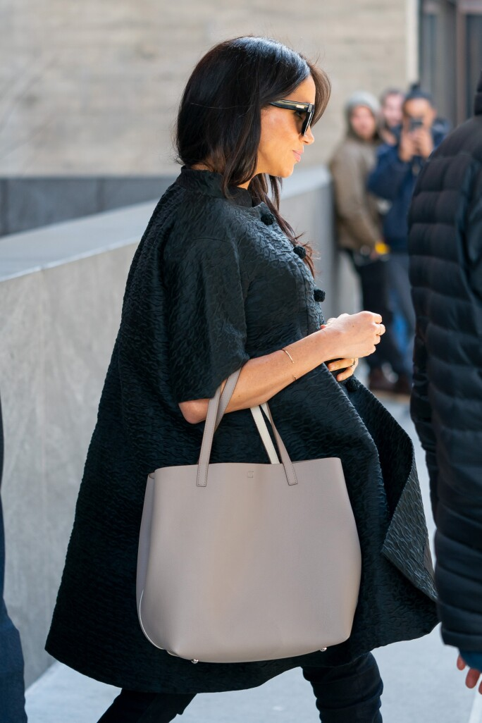 Meghan, Duchess of Sussex wears a 1960s Courrèges coat to her baby shower. Photo: Gotham/GC Images
