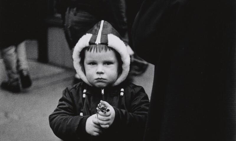 Diane Arbus, Kid in a hooded jacket aiming a gun, N.Y.C, 1957