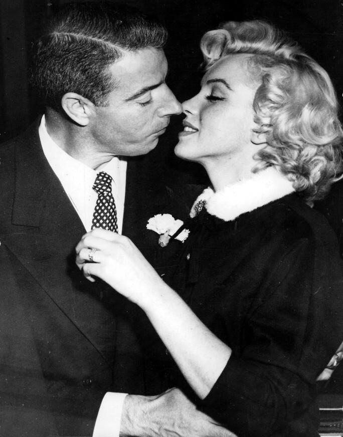 Marilyn Monroe and Joe DiMaggio kiss after their wedding, 1954.