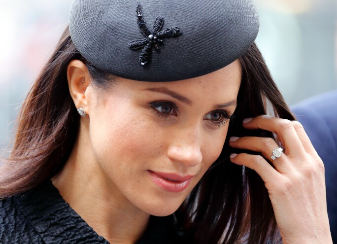 Meghan Markle wearing her cushion cut engagement ring.