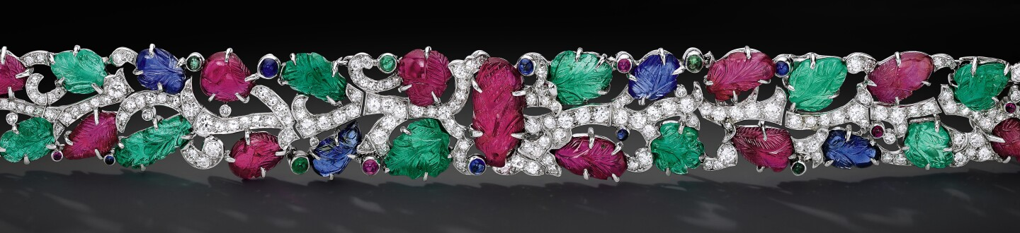 fine jewelry bracelet with diamonds emeralds and sapphires in an auction selling jewelry