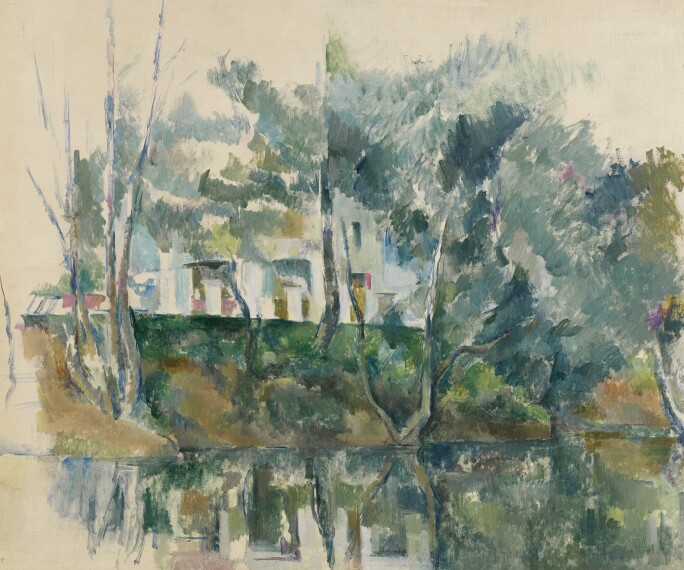 A Cézanne landscape of houses and trees reflected in nearby water.