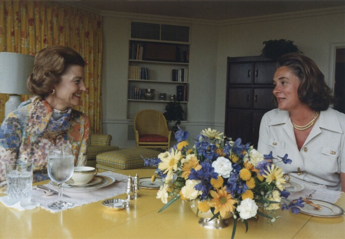 First Lady Betty Ford and Happy Rockefeller talk in the White House Solarium embrace.