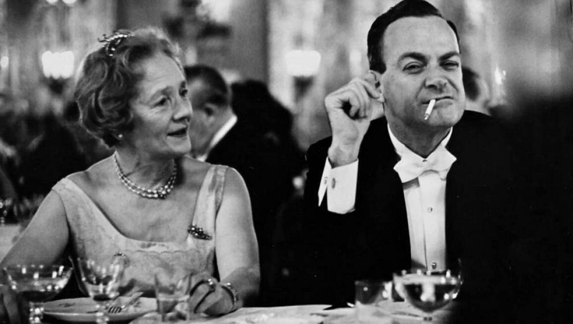 Physicist Richard Feynman at the 1965 Nobel Banquet making a funny face with a cigarette in his mouth.