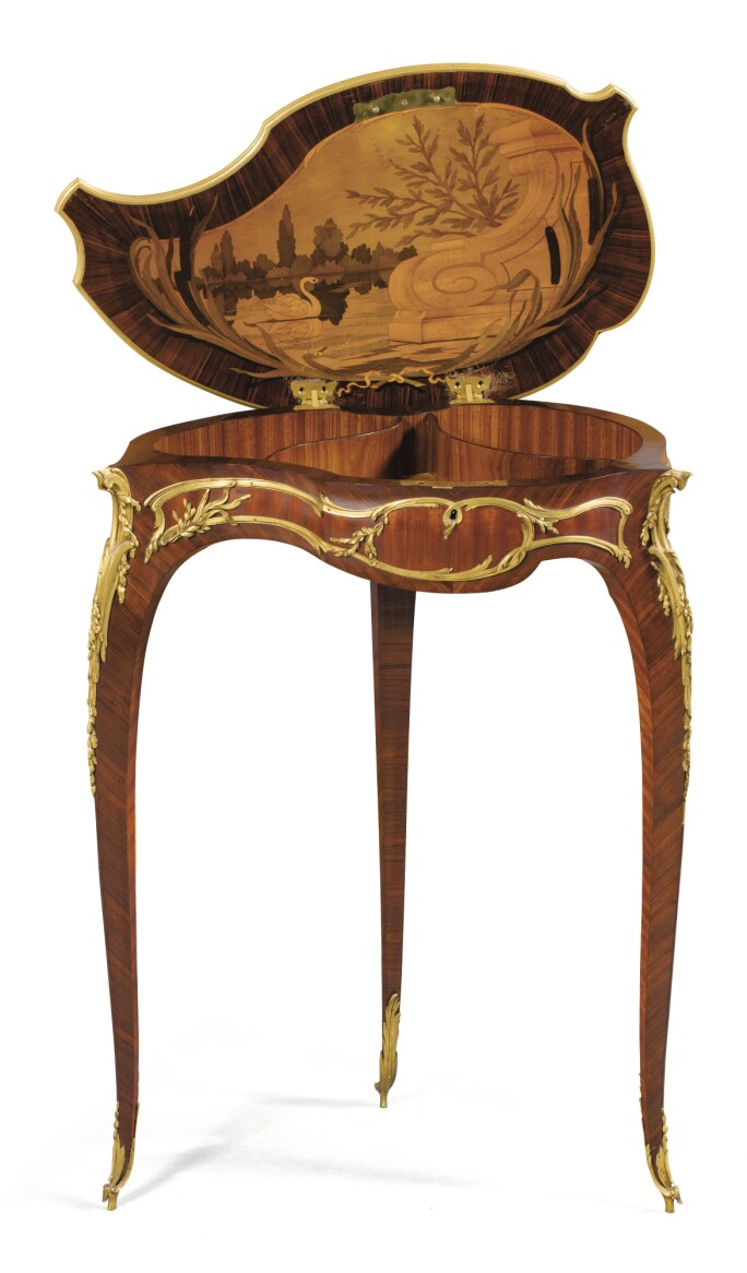 "A French gilt-bronze mounted kingwood, satiné, holly and hornbeam marquetry ""Coquille"" table by François Linke, index number 544, circa 1900."