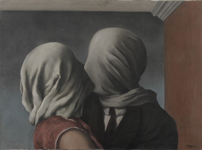 A man and woman kissing with white sheets over their heads.