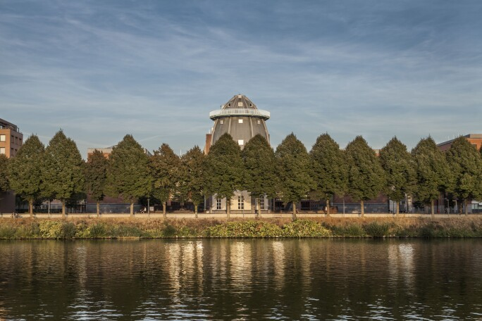 A view of the Bonnefantenmuseum from across the scenic Maas River