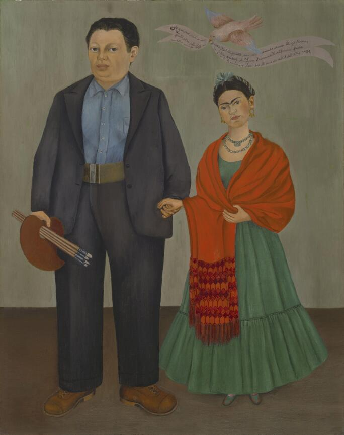 Frieda Kahlo standing next to Diego Rivera in a wedding portrait she painted