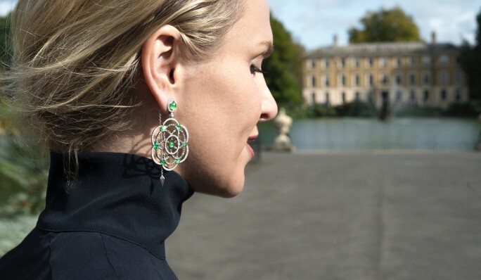 Lily Gabriella wearing white and grey diamond Damali earrings with hand cut green tsavorites from her own collection