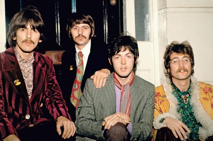 Publicity photo of The Beatles (George Harrison, Ringo Starr, Paul McCartney and John Lennon) at Abbey Road Studios