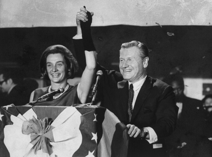 Nelson & Happy Rockefeller rejoice at a podium