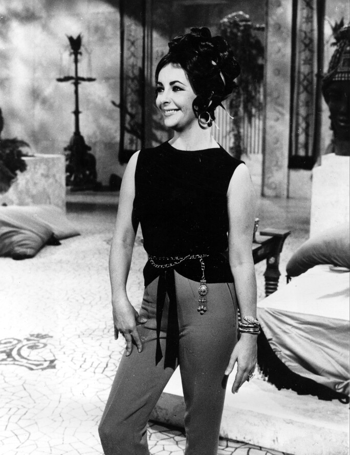 Elizabeth Taylor wearing a Bulgari 'serpentini' watch on set of Cleopatra