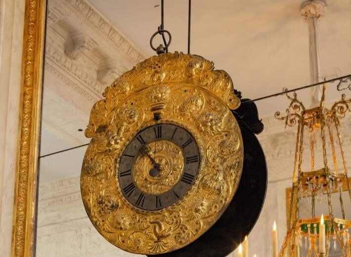 An Austrian hanging clock from the 17th century in an auction selling antique clocks