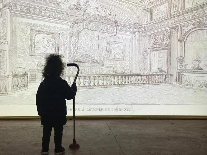 Image of Child in front of Illustration at Zumu