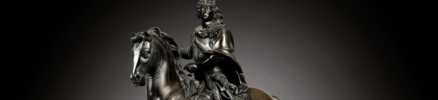 A bronze equestrian statue of Louis XIV in an auction selling bronze sculpture