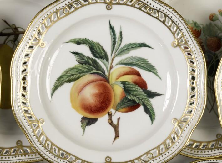Royal Copenhagen fruit plate in an auction selling Royal Copenhagen china