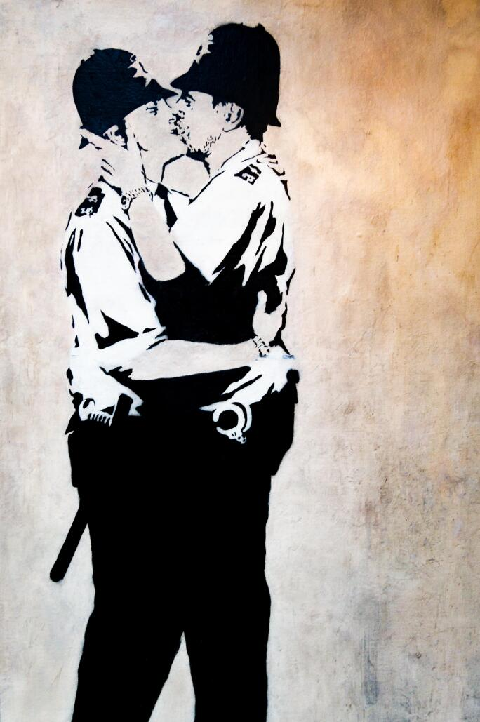 Banksy's work Kissing Coppers shows two UK police officers kissing.