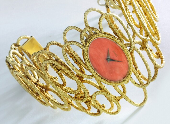 A lady's watch by Piaget with gold and coral in an auction selling piaget watches