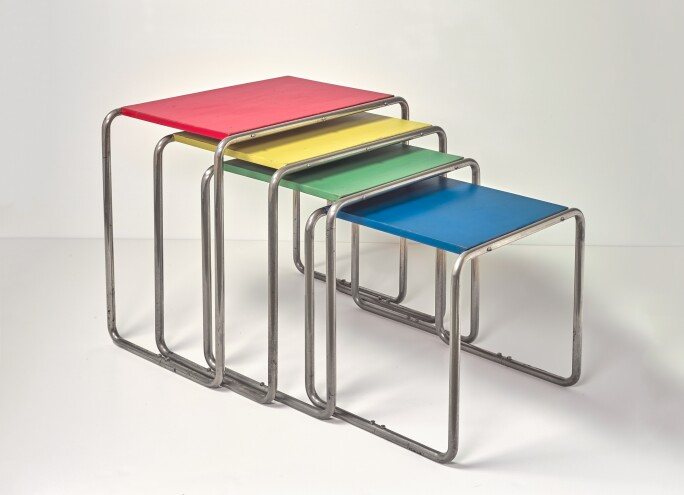 Marcel-Breuer,-four-side-tables,-circa-1926,-nickel-plated-metal,-wood-in-four-colors,-(the-largest-table)Collection-Büscher,-Cologne.jpg