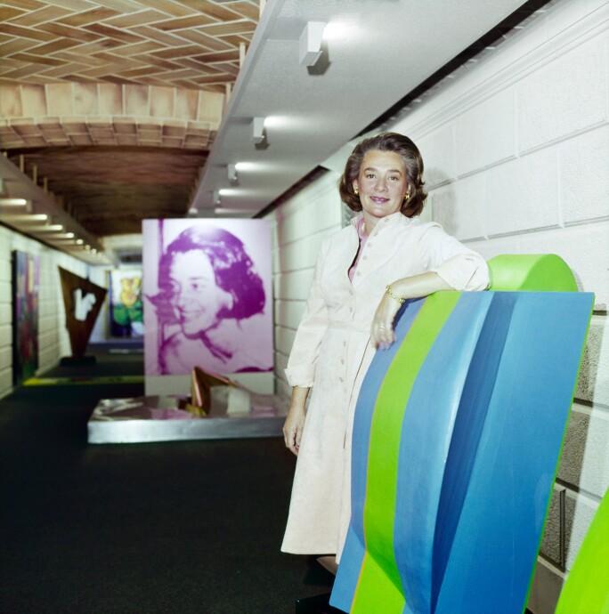 Happy Rockefeller standing with art