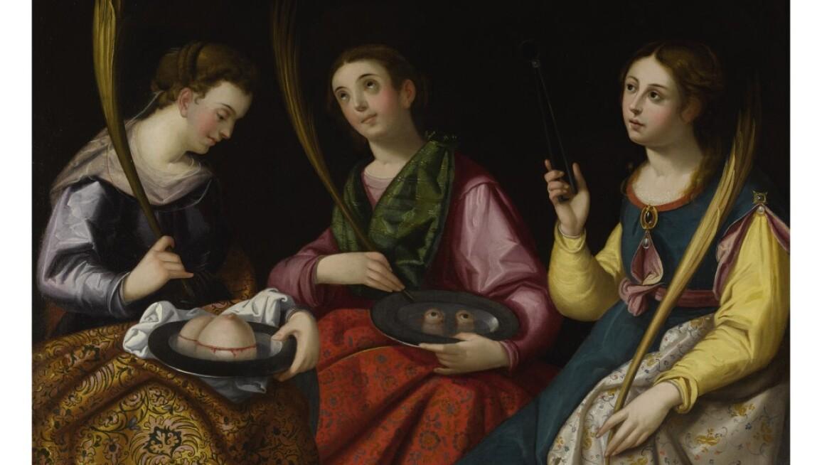 Three women saints in rich fabrics, holding their symbols.