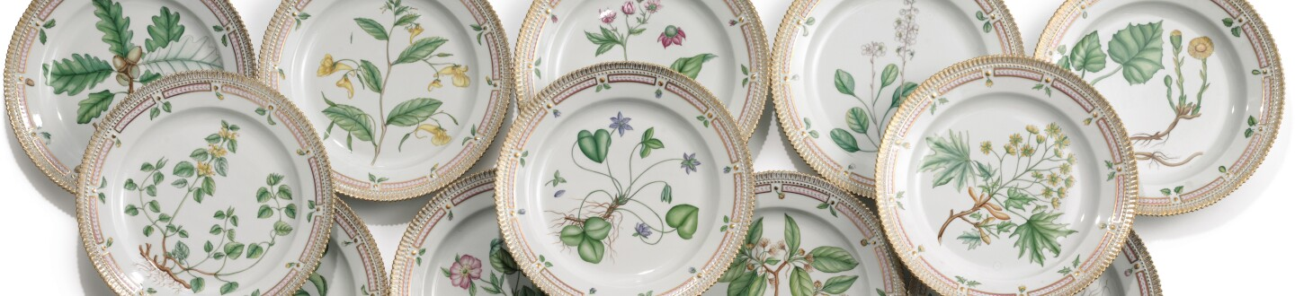 A set of Flora Danica dinner plates in an auction selling Royal Copenhagen china