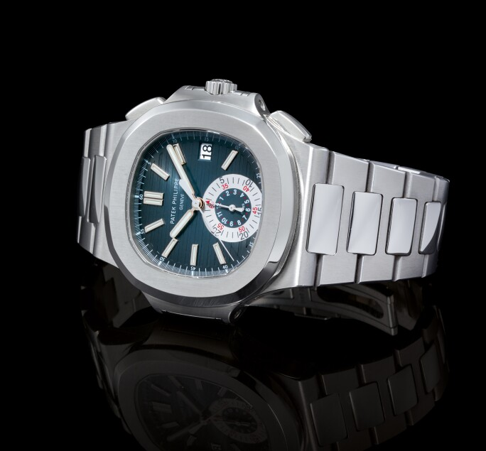 Patek Philippe, NAUTILUS, REFERENCE 5980 A STAINLESS STEEL FLYBACK CHRONOGRAPH BRACELET WATCH WITH DATE, MADE IN 2009. Estimate $30,000-50,000