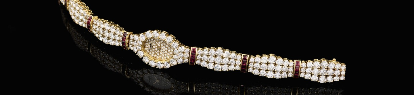 A women's Chopard watch with diamonds and rubies in an auction selling chopard watches