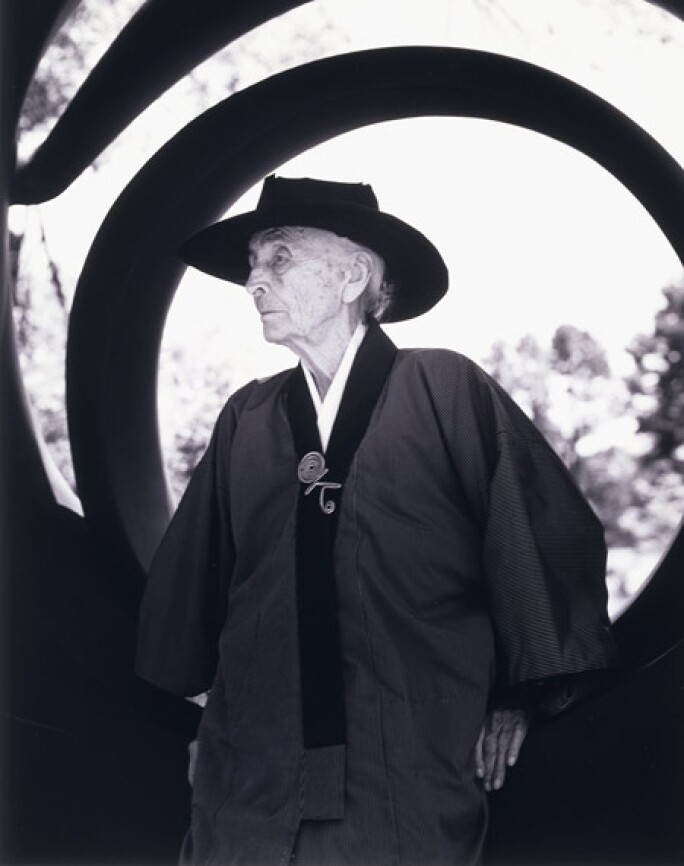 Georgia O'Keeffe wearing a brooch by Alexander Calder