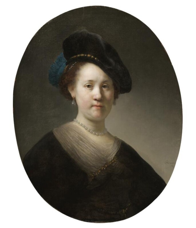 A portrait of a woman with a black velvet cap and a blue plume.