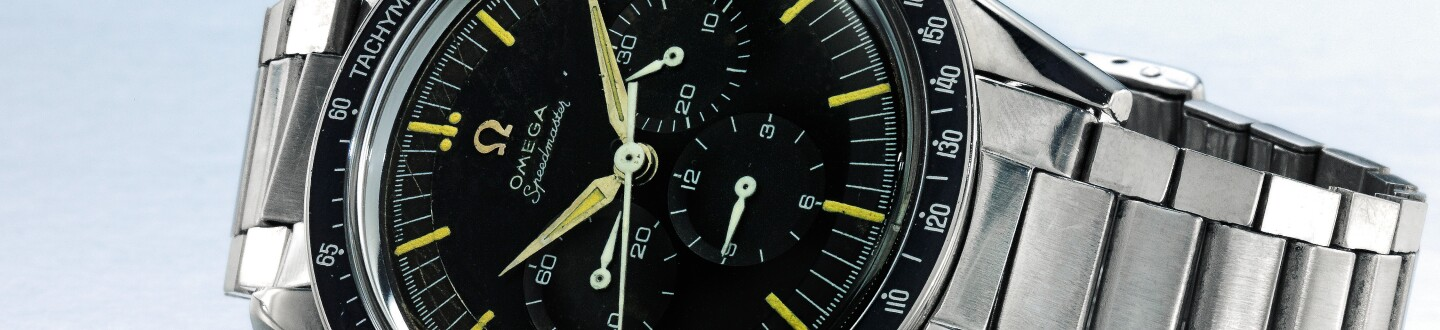 An Omega stainless steel Speedmaster watch in an auction selling Omega watches