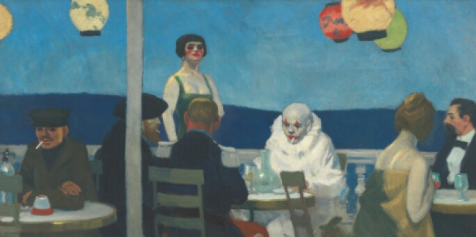 Seaside cafe with a clown seated at a table in full makeup with white face mask smoking a cigarette.
